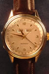 movado automatic gold topped watch